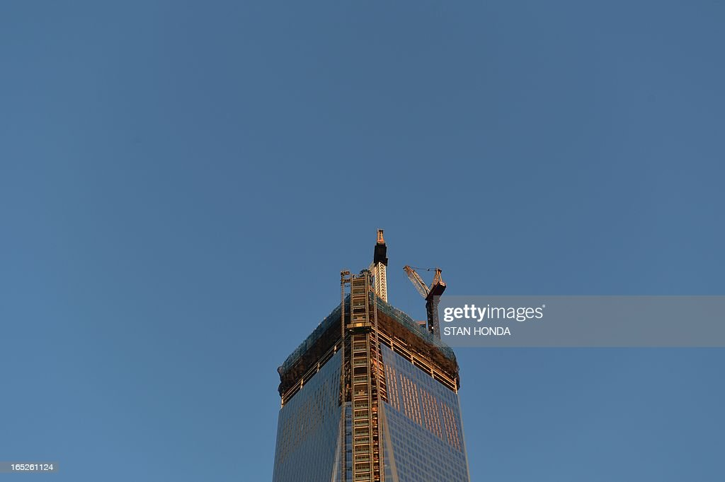 A view of the top of One World Trade Center as officials from The Durst Organization, Legends Hospitality LLC and The Port Authority of New York & New Jersey give a preview to the news media of the One World Observatory site, the planned public observation deck under construction on the 100th floor of One World Trade Center April 2, 2013 in New York. AFP PHOTO/Stan HONDA