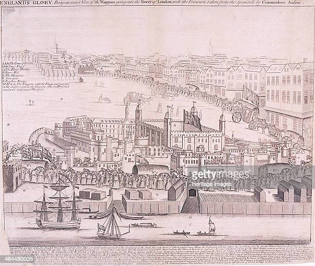 View of the Tower of London from the River Thames showing a procession with waggons going into the Tower of London loaded with the treasure taken...