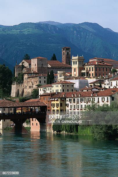View of the town and Ponte Vecchio or Ponte degli Alpini over the Brenta river designed by Andrea Palladio in 1569 Bassano del Grappa Veneto Italy