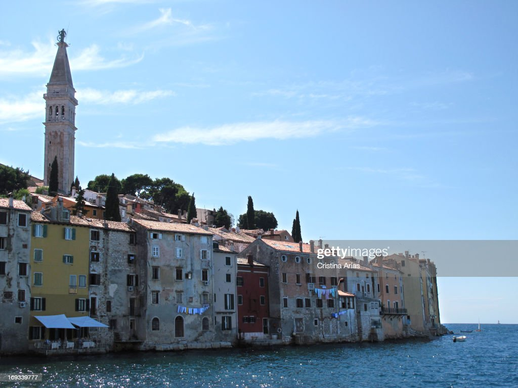 View of the town of Rovinj with the bell tower of the church of St Euphemia stressing above the houses that open directly to the sea Istria Croatia