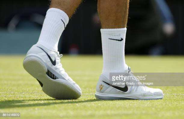 A view of the trainers worn by Switzerland's Roger Federer in his match against Ukraine's Sergiy Stakhovsky during day Three of the Wimbledon...