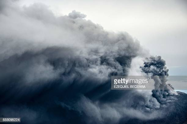 TOPSHOT View of the Turrialba volcano on May 20 in Cartago Costa Rica as it entered intense eruptive activity The Turrialba volcano started erupting...
