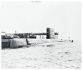 A view of the USS Nautilus the world's first atomic powered submarine at the fittingout dock of the builders the electric boat division of General...