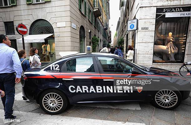 A view of the Via della Spiga street with a police car after the robbery at watchmaker Franck Muller store on May 21 2013 in Milan Italy The thieves...