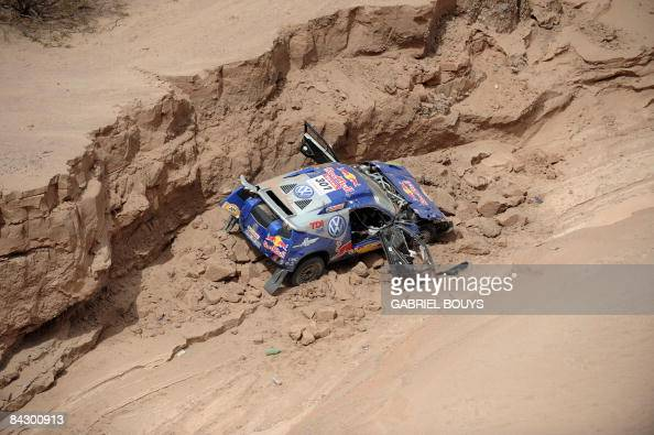 View of the Volkswagen belonging to Spain's twotime rally world champion Carlos Sainz who was leading the race who crashed during the 12th stage of...