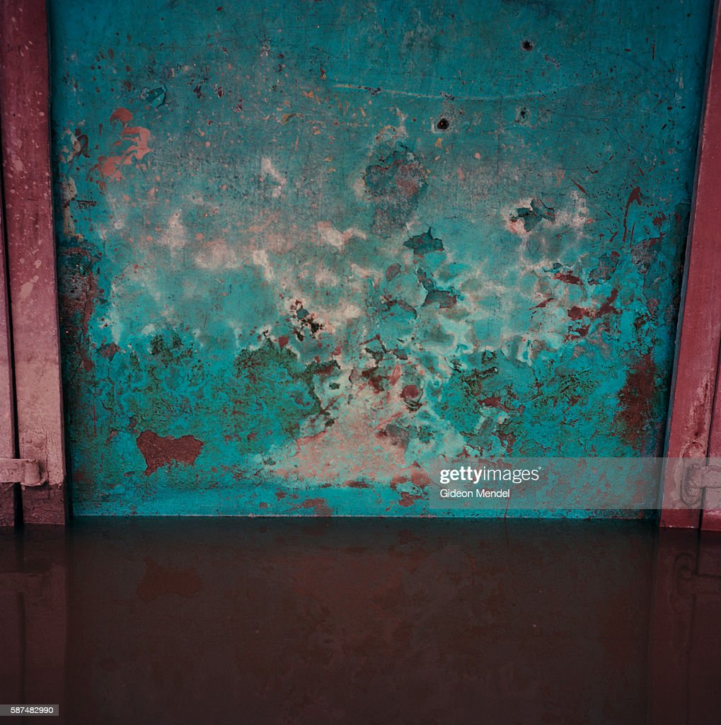 A view of the wall of a flooded house in Gonaives two weeks after it was flooded during Hurricanes Ike and Hanna The window shutters can be seen on...