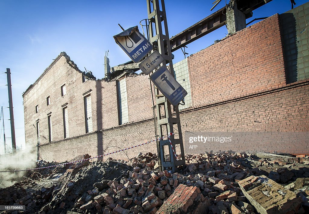 A view of the wall of a local zinc plant which was damaged by a shockwave from a meteor in the Urals city of Chelyabinsk, on February 15, 2013. A meteor strike in central Russia that left today hundreds of people injured is the biggest known human toll from a space rock, a British expert said. AFP PHOTO / 74.RU/ OLEG KARGOPOLOV SOURCE--