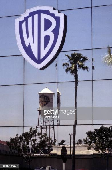 A view of the Warner Brothers logo on a building with a palm tree in the reflection in April 1991 in Burbank California