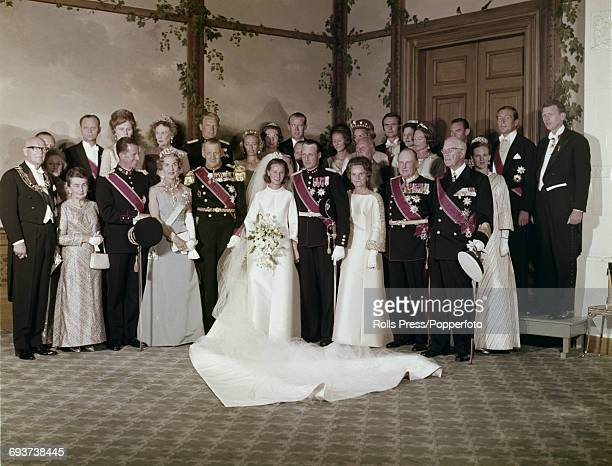 View of the wedding party of Crown Prince Harald of Norway pictured with his wife Sonja Haraldsen family members and guests following the wedding...