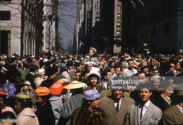 View of the welldressed crowd attending the Easter Sunday service at New York City's St Patrick's Cathedral on 5th Avenue and 51st street 1958