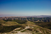The landscape in the Westbank is immensely diverse. In this case we see green, then desert, then the Dead Sea (on the left) and all the way in the back we find Jordan.