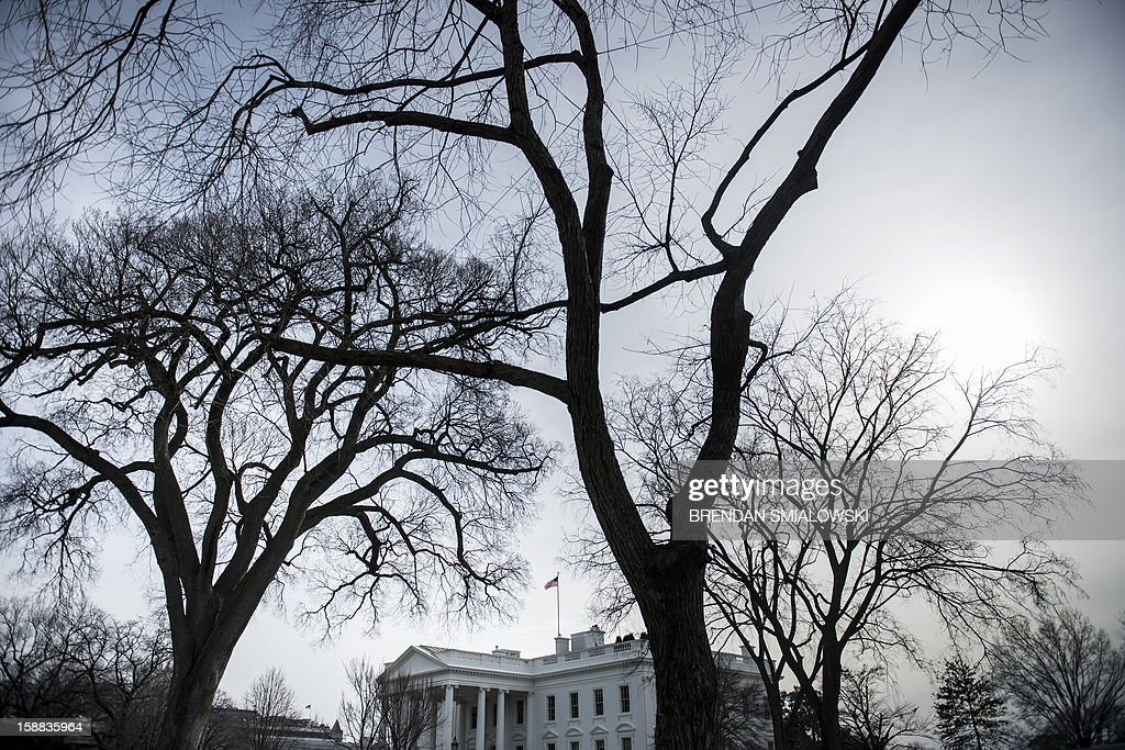 A view of the White House December 31, 2012 in Washington, DC. Lawmakers in Washington continue to work on a last minute compromise to pass legislation to avoid a fiscal cliff of tax hikes and spending cuts in the United State's federal budget. Lawmakers were aiming to bring a bill to the Senate floor that would keep tax breaks on the books for middle-class Americans while letting those for the rich expire. AFP PHOTO/Brendan SMIALOWSKI