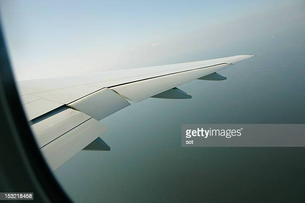 View of the wing through an airplane window