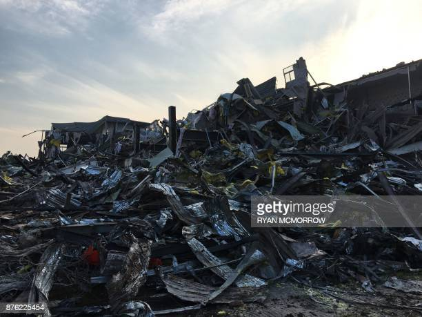 View of the wreckage after a fatal housing block fire in Beijing on November 19 2017 Chinese authorities on November 19 launched an investigation...
