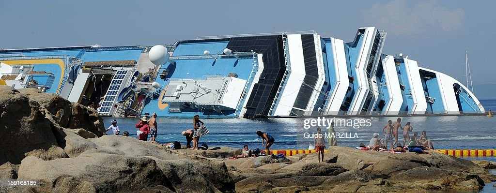 View of the wreckage of capsized cruise liner Costa Concordia at Giglio Island, Italy on July 2012. The 290-metre-long cruise liner partly sank on January 13, 2012 with 3,206 passengers and 1,023 crew members on board after hitting a reef off the Italian coast.