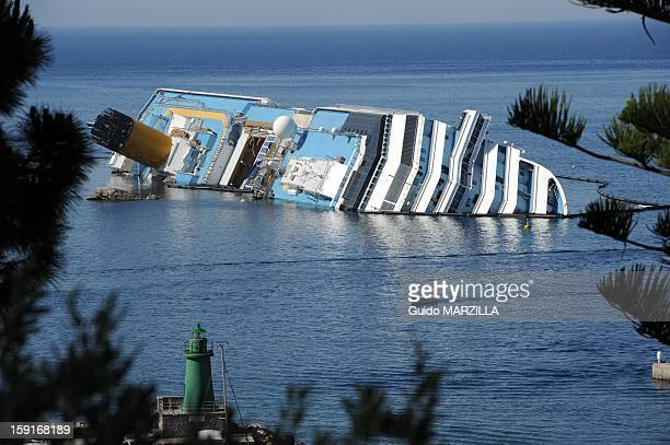 View of the wreckage of capsized cruise liner Costa Concordia at Giglio Island Italy on July 2012 The 290metrelong cruise liner partly sank on...