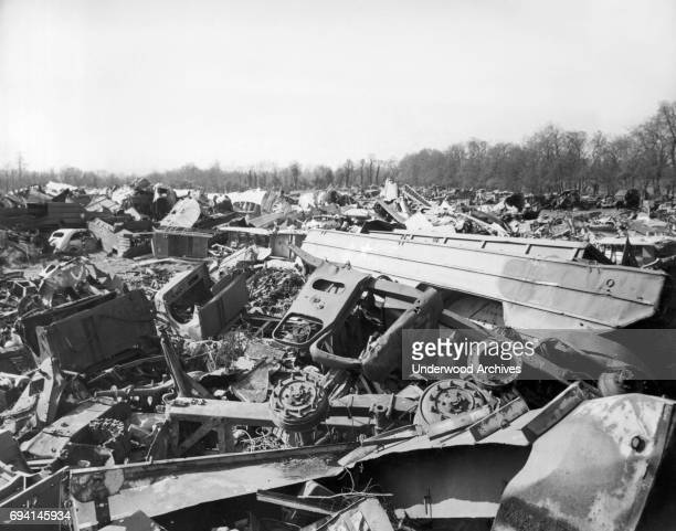 View of the wreckage of various military vehicles include both amphibious trucks called DUKWs and aircraft discarded along the St LoCarentan road...