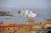 View of the wrecked cruise liner Costa Concordia on January 16 in the harbour of the Tuscan island of Giglio after it ran aground after hitting...