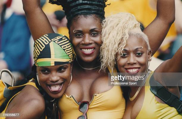 View of three female football fans supporting the Jamaica national football team at the 1998 FIFA World Cup in France in June 1998 The Jamaica team...