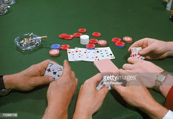 View of three hands in a game of Texas Hold 'Em one with a pair of sevens one a pair of sixes and the other an eight and ten August 1968