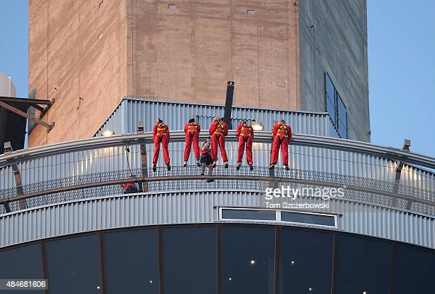 A view of thrill seekers atop the Edge Walk on the CN Tower during the Toronto Blue Jays MLB game against the Minnesota Twins on August 6 2015 at...