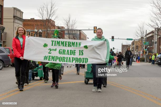 View of Timmerman Elementary School's second grade class as they march in the annual Saint Patrick's Day Parade Emporia Kansas March 11 2017