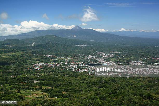 View of Tomohon town and Soputan Volcano from summit of Mahawu Volcano