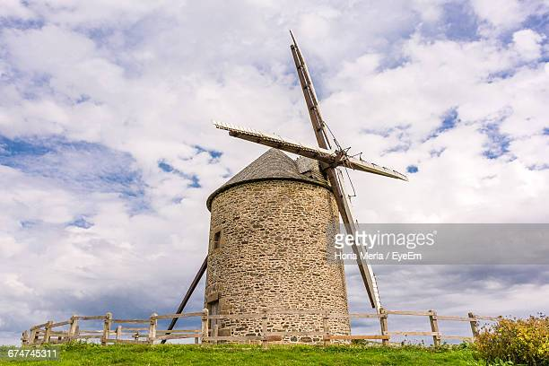 View Of Traditional Windmill Against Sky