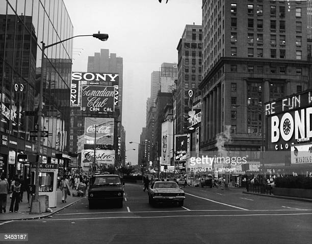 View of traffic and billboards from the corner of Broadway and West 44th Street Times Square New York City 1970s