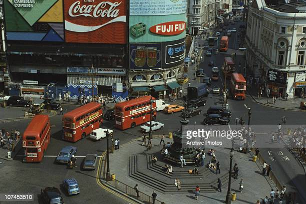 A view of traffic and the statue of Eros in Piccadilly Circus London 1979