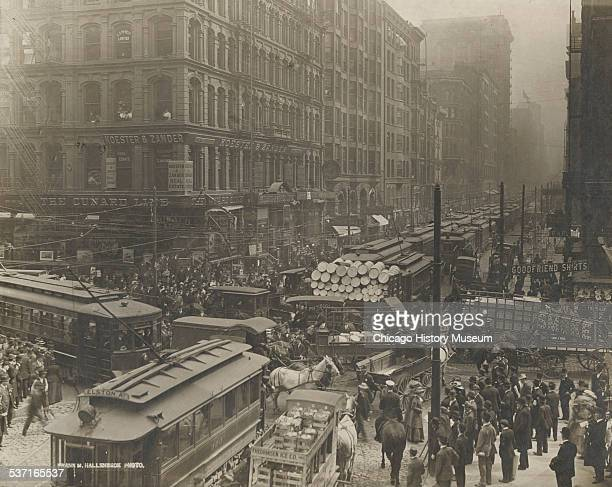 View of traffic congestion on Dearborn Street south from Randolph Street in Chicago Illinois 1909 Several trolleys and horsedrawn carts are visible