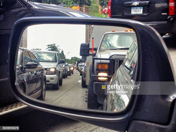 View of traffic jam through rearview mirror on West Side Highway NYC
