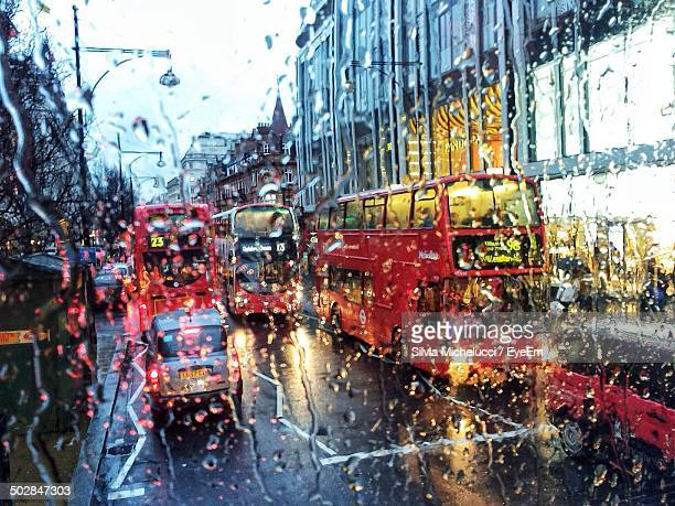 View of traffic through wet window