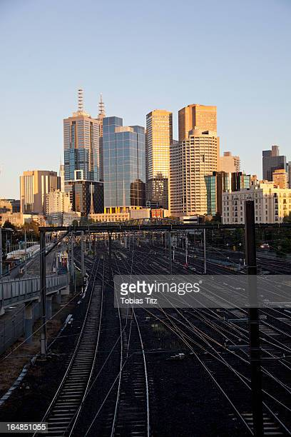 View of train tracks and city buildings, Melbourne, Victoria, Australia