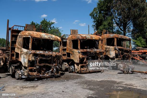 View of trucks belonging to forestry companies burnt early this year during clashes with Mapuche people in Temuco on November 08 2017 The Mapuches...