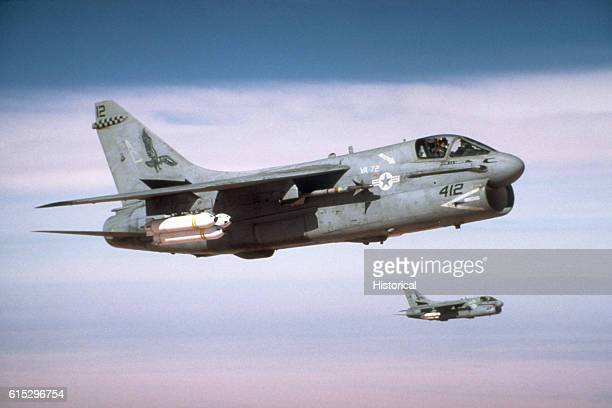 A view of two Attack Squadron 72 A7E Corsair aircraft en route to their targets during Operation Desert Storm The aircraft are carrying Mark 20...