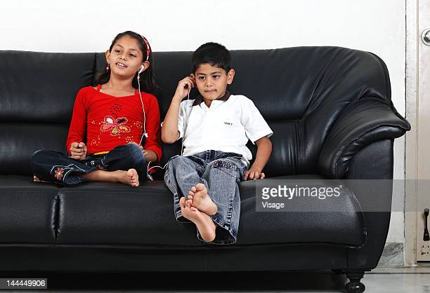 View of two kids listening to music