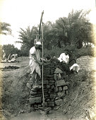 View of two men working at oasis well Egypt circa 1881
