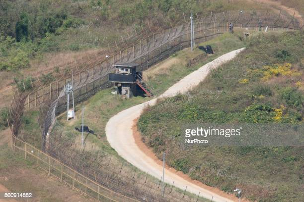 View of two South Korean soldiers working near an army observation post from Dora Observatory at the Demilitarized Zone dividing two Koreas October...