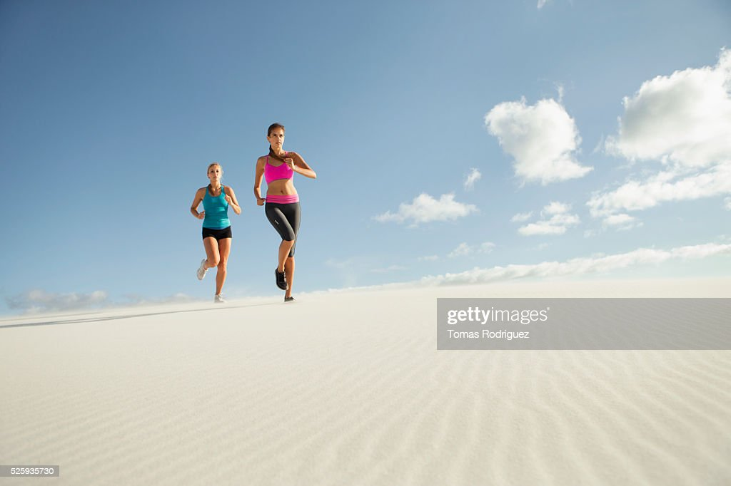View of two young adult women jogging : Stock Photo