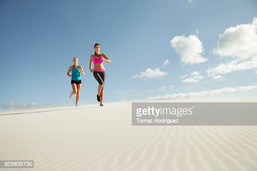 View of two young adult women jogging : Stock-Foto