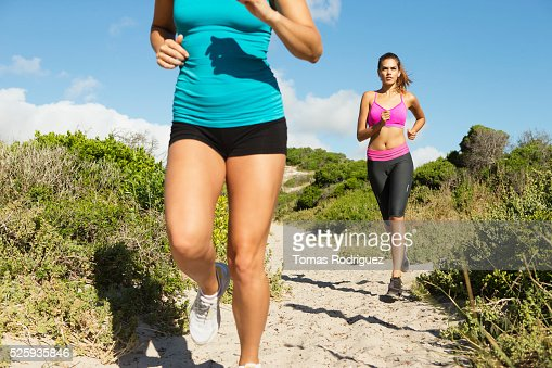 View of two young adult women jogging : Foto stock
