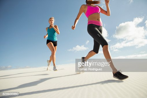 View of two young adult women jogging : Foto de stock