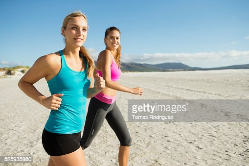 View of two young adult women jogging : ストックフォト