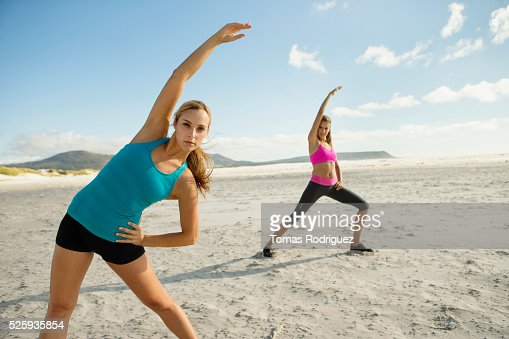 View of two young adult women, stretching arms : ストックフォト