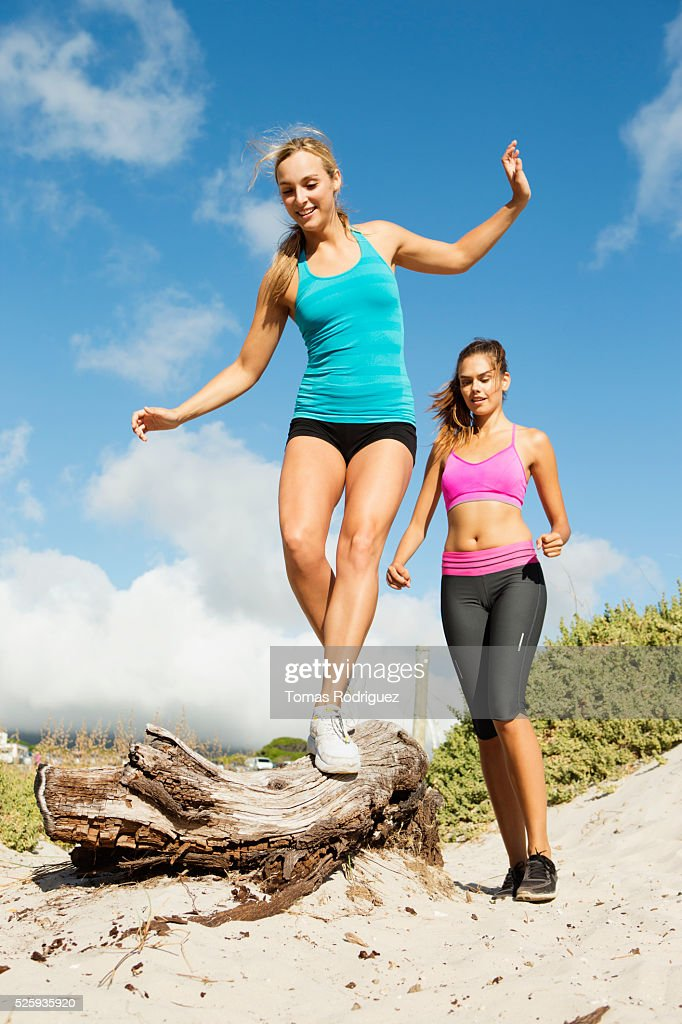 View of two young adult women wearing sports clothing : ストックフォト