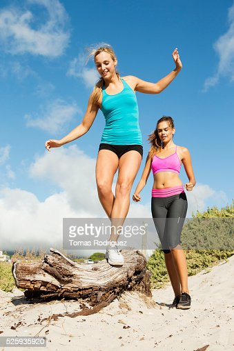View of two young adult women wearing sports clothing : Stock Photo
