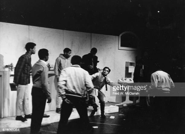 View of unidentified cast members in a scene from the play 'The Toilet' at the St Marks Playhouse New York New York December 13 1964
