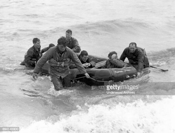 View of unidentified survivors in a life raft from a sunken LCVP as they make to shore at Omaha Beach during the invasion of Normandy Normandy France...