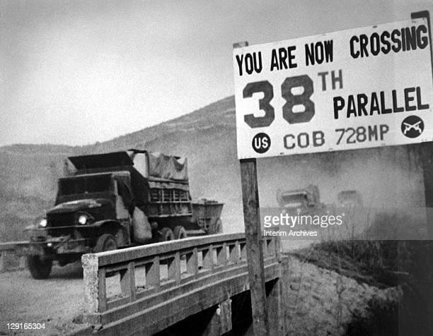 View of United Nations forces traveling in trucks crossing the 38th parallel as they withdraw from Pyongyang the North Korean capital 1950